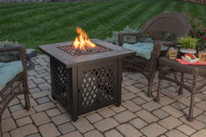 The Endless Summer LP Gas Outdoor Firebowl with Slate Tile Mantel is powered by propane, crafted from weather-resistant steel, and decorated with all the hallmarks of classic, high-end furniture