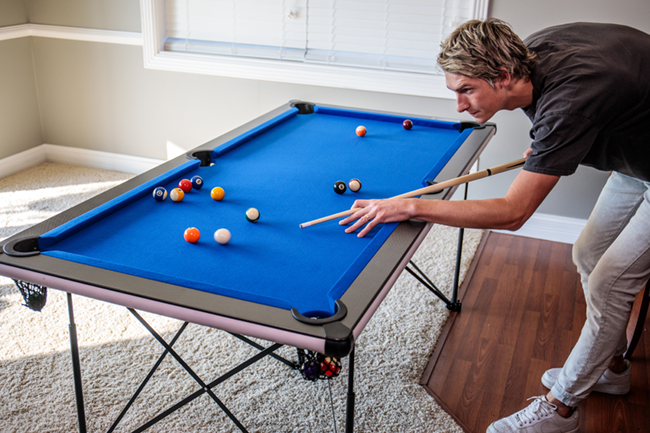 The brand's 6' Popup Portable Folding Billiard Table offers the same quality, with stylish blue cloth, fiber-finished top rails, and a popup frame that's easy to assemble.