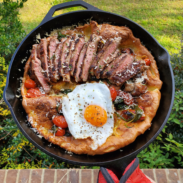 RECIPE: Steak and Egg Dutch Baby with Sautéed Spinach and Blistered Tomatoes