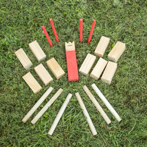 The Triumph Sports Kubb Lawn Game Set offers a more unique gaming experience